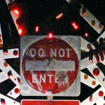 Do Not Enter • Installation and Performance with 40 Minute Sound Loop, Repurposed Street Sign, Painted Wood Shards with Flashing Bicycle lights and Reflectors, 115 x 160 x 48 inches (292.1 x 406.4 x 121.92 cm)