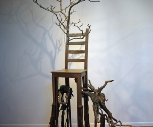 Deception, Mixed Media Black Walnut Branch, Chair, Acrylic Paint, Sumac Roots and Faux Roots, Black Walnuts, Potting Soil 109 inches x 40 inches x 50 inches (277 cm x 101 cm x 127 cm)