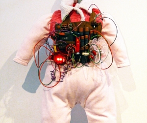 Pinkie, Infant Suicide Bomber Vest Model #2010-2011TL • Mixed Media, R.A.M.S.E.S. Recycled-Assembled-Miscellaneous-Surplus-Engineered-Scrap, 24 X 18 x 12 inches (60.96 x 45.72 x 30.48 cm)