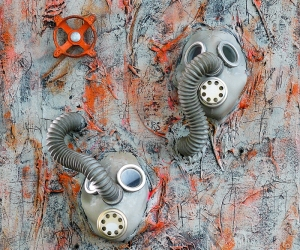 Only Two, 2010 , Mixed Media Tar, Plaster Wrap and Acrylic on Panel with World War I Gas Masks and Faucet Valve, Sonic (Singing) Interactive: Speakers mounted at hose end with sound exiting mask's speaker, Electronics mounted on back, 24 X 18 inches (61 x 46 cm)
