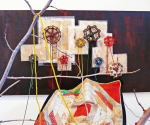 The Visit (Detail 2) • Installation, Acrylic and Tar on Panel with Painted Canvases in Plexiglas, Faucet Valves with Painted Strings, Piece of a Civil War Era Quilt, Dead Tree and Reflecting Pool, 80 x 72 x 60 inches (variable tree size) (203.2 x 182.88 x 152.4 cm)