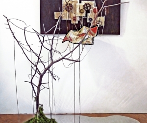 The Visit • Installation, Acrylic and Tar on Panel with Painted Canvases in Plexiglas, Faucet Valves with Painted Strings, Piece of a Civil War Era Quilt, Dead Tree and Reflecting Pool, 80 x 72 x 60 inches (variable tree size) (203.2 x 182.88 x 152.4 cm)