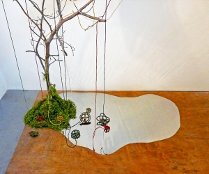 The Visit (Detail 4) • Installation, Acrylic and Tar on Panel with Painted Canvases in Plexiglas, Faucet Valves with Painted Strings, Piece of a Civil War Era Quilt, Dead Tree and Reflecting Pool, 80 x 72 x 60 inches (variable tree size) (203.2 x 182.88 x 152.4 cm)