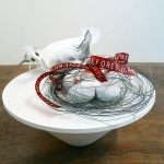 Remove Before Flight #1, 2009, Mixed Media, Wire, Acrylic Painted Plastic Eggs, Airplane Surplus, Paper Maché Bird,  20 x 18 x 18 inches (50.8 x 45.72 x 45.72 cm)