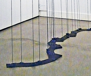 21 Attenuations • Installation, Acrylic on Wood Panel, Acrylic Painted Strings, Faucet Valves and Industrial Steel Mesh, Variable Height up to 240 x 96 x 48 inches (up to Height of 609.6 x 243.84 x 121.92 cm)